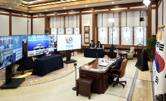 In this file photo, President Moon Jae-in participates in the virtual summit of the Association of Southeast Asian Nations (Asean) with Korea, Japan and China at the Blue House on April 14, 2020.  [YONHAP]