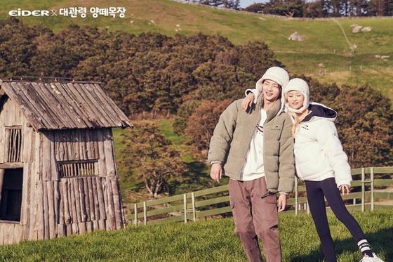 Models wear Eider's fleece jackets and matching trapper hats at Daegwallyeong Sheep Ranch. [EIDER]