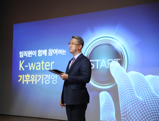 Park Jae-hyeon, CEO of K-water, presents the company's plans to combat the climate crisis during the company's 53rd anniversary ceremony held in Daejeon on Monday. [K-WATER]