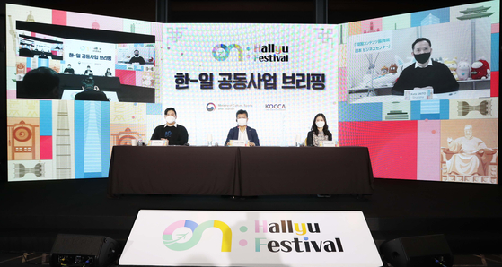"""Participants of the Korea-Japan Joint Content Production Presentation held during the first 'ON: Hallyu Festival"""" in Coex, southern Seoul, sit for a briefing. From left are: Toyou's Dream's Japan business department manager Ko Cha-ram, Park Seung-ryong, general director of the global business division at Kocca, Seoul Media Comics' (SMC) team director Lee Eun-seon and Japanese publishing company Shueisha's chief editor Kota Saito. [KOCCA]"""