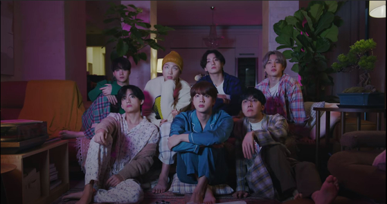 """A scene from the video teaser of """"Life Goes On"""" featuring the BTS members in pajamas. [SCREEN CAPTURE]"""