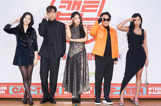 "From left, M.C. Jang Ye-won, Shownu of boy band Monsta X, singers Soyou and Lee Seung-chul and rapper Jessi pose for the camera during the press event for Mnet's audition program ""Cap-Teen"" held on Thursday. [MNET]"