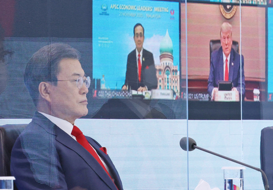 President Moon Jae-in on Friday participates from the Blue House during a virtual summit of the Asia-Pacific Economic Cooperation. [YONHAP]