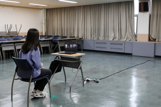 A student sits for a virtual interview for early admissions at the Hankuk University of Foreign Studies in eastern Seoul on Sunday. [NEWS1]