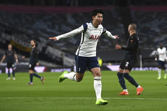 Tottenham Hotspurs' Son Heung-min celebrates after scoring the opener during Spurs' Premier League match against Manchester City at Tottenham Hotspur Stadium on Saturday. [AP]
