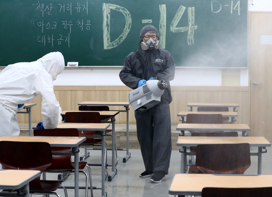 A worker disinfects a hagwon (cram school) in Daejeon Thursday, two weeks before the annual College Scholastic Ability Test (CSAT). [NEWS1]