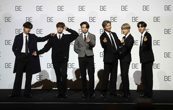 BTS poses for the camera at a global press conference hosted at the Dongdaemun Design Plaza in central Seoul Friday to promote its fifth full-length album, ″BE (Deluxe Edition).″ [JOONGANG ILBO]