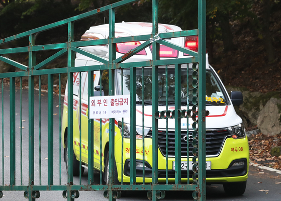 An ambulance leaves St. Raphael's Home, a group home for people with disabilities, in Yeoju, Gyeonggi, on Oct. 25, 2020. The facility was hit by cluster infections of Covid-19, and the Yeoju city government said 41 were infected from the facility as of Nov. 1, 2020.  [YONHAP]