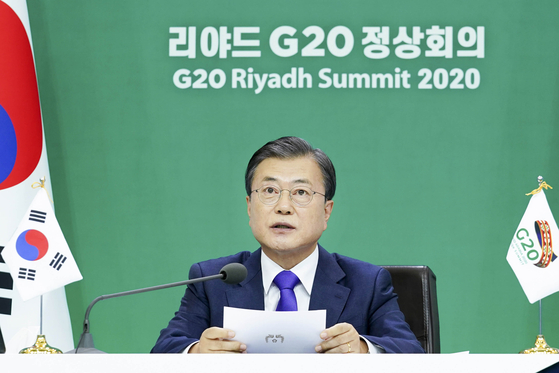 President Moon Jae-in speaks in a virtual meeting of the two-day Group of 20 summit which concluded Sunday. The G-20 leaders adopted a joint declaration calling for the affordable and equitable access of Covid-19 vaccines and therapeutics for all people. [JOINT PRESS CORPS]