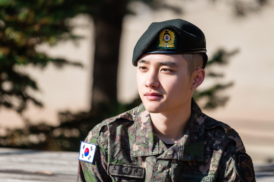 Singer D.O. of boy band Exo takes part in the Military Manpower Administration's ″Pride in Military″ campaign to heighten awareness about mandatory military duties [MMA]