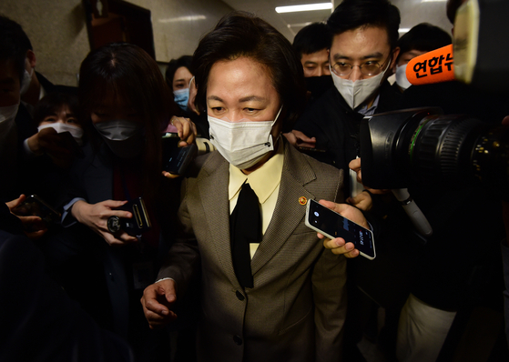 Justice Minister Choo Mi-ae is surrounded by reporters at the National Assembly on Wednesday.  [YONHAP]