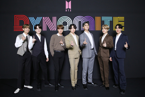 Members of BTS pose together after winning the first No. 1 spot on the Billboard Hot 100 singles chart in September. [BIG HIT ENTERTAINMENT]