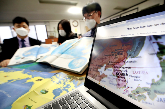 Members of the Voluntary Agency Network of Korea review maps of the East Sea on Nov. 17 as the International Hydrographic Organization plans to name global seas with numerical codes rather than with specific names. Korea and Japan have been feuding over the name of the body of water between the two countries — the East Sea or the Sea of Japan. [YONHAP]
