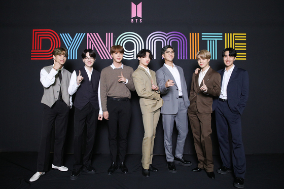Members of BTS pose for photos prior to the online press conference held on Sept. 2 after winning the first No. 1 spot on the Billboard Hot 100 singles chart with ″Dynamite.″ [BIG HIT ENTERTAINMENT]