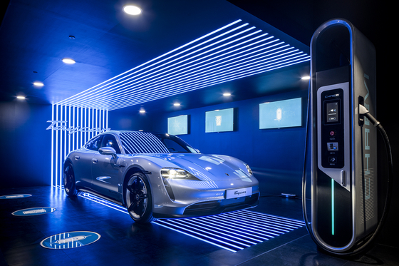 Porsche's all-electric model Taycan 4S is on display at the Porsche Taycan Arena exhibition center set up on Garosu-gil in Sinsa-dong, southern Seoul, on Thursday. The German luxury carmaker launched the Taycan 4S in Korea the same day. [PORSCHE KOREA]