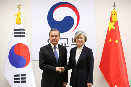 Chinese State Councilor and Foreign Minister Wang Yi, left, poses with Korean Foreign Minister Kang Kyung-wha on Dec. 4, 2019, at the Foreign Ministry in central Seoul. Wang kicks off a three-day visit to Korea Wednesday. [YONHAP]