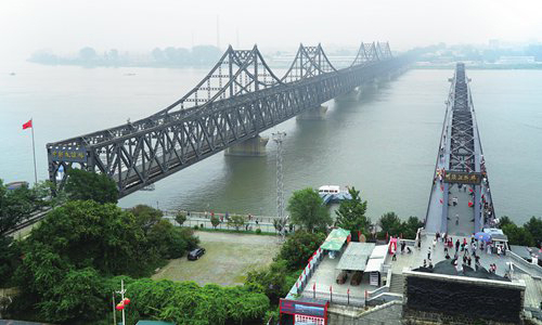 A view of the Yalu River Bridge, which connects Sinuiju, North Korea and Dandong, China. China is the North's biggest trade partner. [AP PHOTO/EMILY WANG]