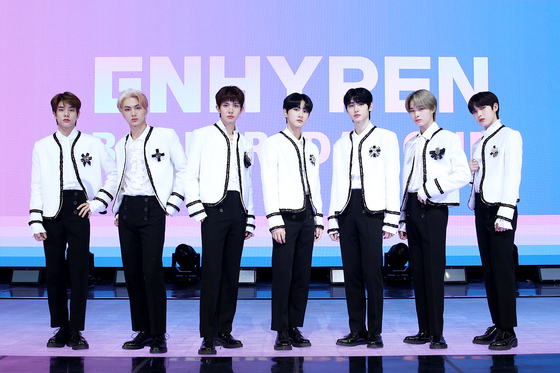 Boy band Enhypen stands for photos on Monday during an online showcase held for its first EP ″Border: Day One.″ [BELIFT LAB]