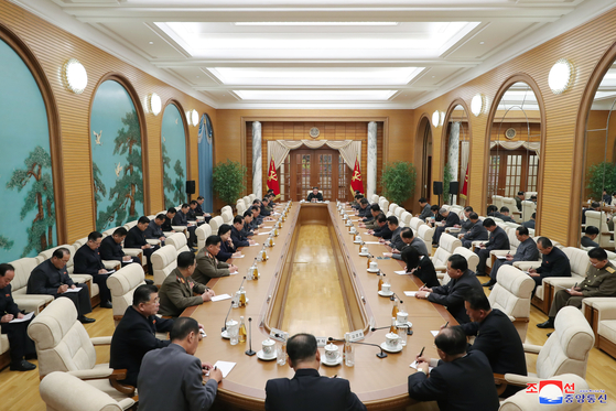 """North Korea holds an enlarged meeting of its ruling Workers' Party Political Bureau in Pyongyang on Sunday, with full and alternate members in attendance, in a photograph released by the Korean Central News Agency. During the meeting, economic officials were """"harshly criticized,"""" according to the state-run news service. [YONHAP]"""