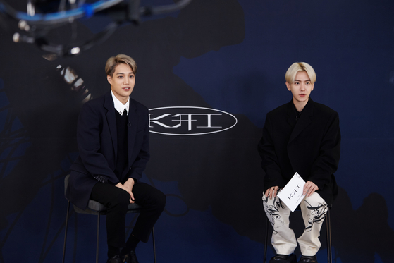 Singer Kai sits down with member Baekhyun of Exo on Monday morning for his first solo album ″KAI.″ [SM ENTERTAINMENT]