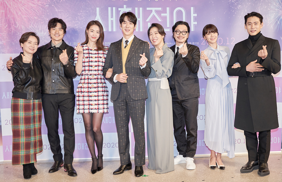 """From left, director Hong Ji-young, actors Kim Kang-woo, Lee Yeon-hee, Yoo Yeon-seok, Yeom Hye-ran, Lee Dong-hwi, Choi Soo-young and Teo Yoo pose for the camera at an online press event for upcoming film """"New Year Blues"""" held on Tuesday. [ACEMAKER MOVIEWORKS]"""
