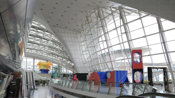 """The virtual reality (VR) exhibition """"Beyond Reality over Incheon Airport,"""" organized by Bucheon International Fantastic Film Festival (Bifan), is being held at Incheon International Airport Terminal 1. [BIFAN]"""
