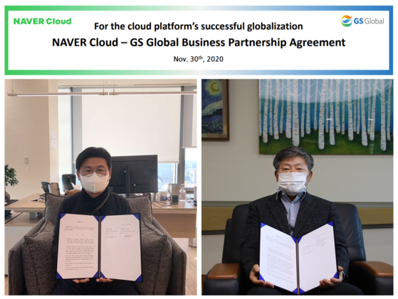 Naver Cloud CEO Park Weon-gi, left, and GS Global CEO Kim Tae-hyung pose during a ceremony to mark the start of the two companies' partnership on Sunday. [NAVER CLOUD]