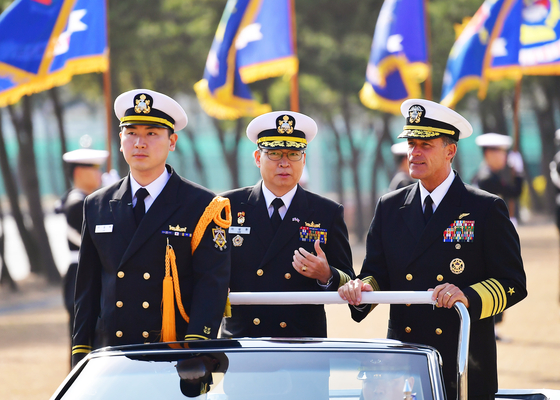 U.S. Pacific Fleet Commander Adm. John Aquilino, right, the prospective nominee to lead the U.S. Indo-Pacific Command, salutes troops with South Korea's Fleet Commander Vice Adm. Lee Seong-hwan, center, during his visit to South Korea in February. [NEWS1]an, center, during his visit to South Korea in February. [NEWS1]