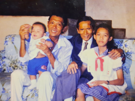 Valentin Flores, Filipino veteran of the Korean War, second from right, with his family in this photo taken before his death. [ROSALYN FLORES]