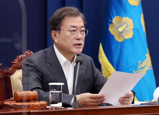 In this file photo, President Moon Jae-in hosts the weekly cabinet meeting through a videoconference from the Blue House on Tuesday.  [YONHAP]