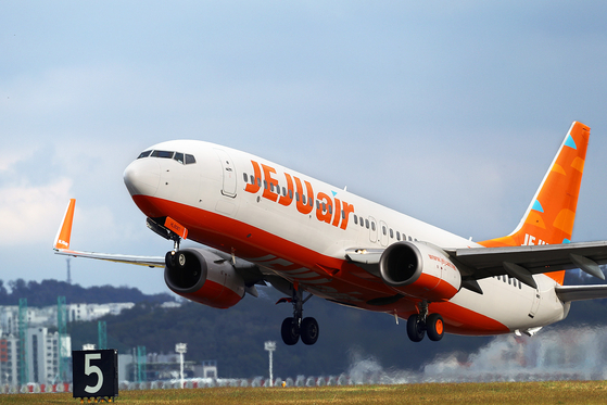 A Jeju Air plane takes off from an airport. [YONHAP]