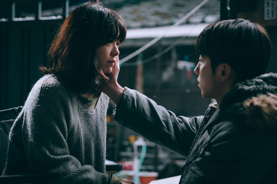 Scenes from the film ″Josee,″ set to premiere in local theaters on Thursday. Actor Han Ji-min portrays Josee and Nam Joo-hyuk as Young-seok, her romantic interest. [WARNER BROS KOREA]