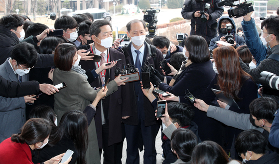 Yoon's lawyers, including Lee Wan-kyu, right, answer the reporters' questions before entering the Justice Ministry's disciplinary hearing against Prosecutor General Yoon Seok-youl. [YONHAP]