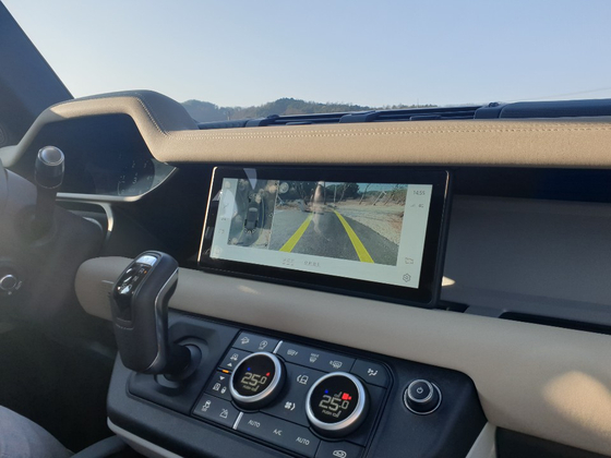 The infotainment screen shows detailed rear and surround view when on a rear gear. [JIN EUN-SOO]