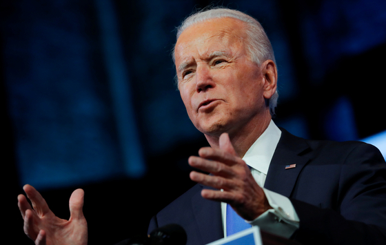U.S. President-elect Joe Biden delivers a televised address to the nation after the U.S. Electoral College formally confirmed his victory over President Donald Trump in the 2020 U.S. presidential election, from Biden's transition headquarters at the Queen Theater in Wilmington, Delaware, on Monday.  [REUTERS]