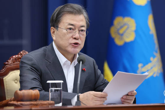 President Moon Jae-in hosts a cabinet meeting via videoconference call from the Blue House on Tuesday.  [YONHAP]