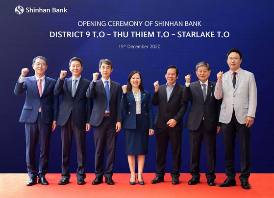 Related officials including Shin Dong-min, CEO of Shinhan Bank Vietnam, far left, pose for a photo in Ho Chi Minh City, Vietnam, at the bank's opening ceremony for three new branches on Tuesday. [SHINHAN BANK]