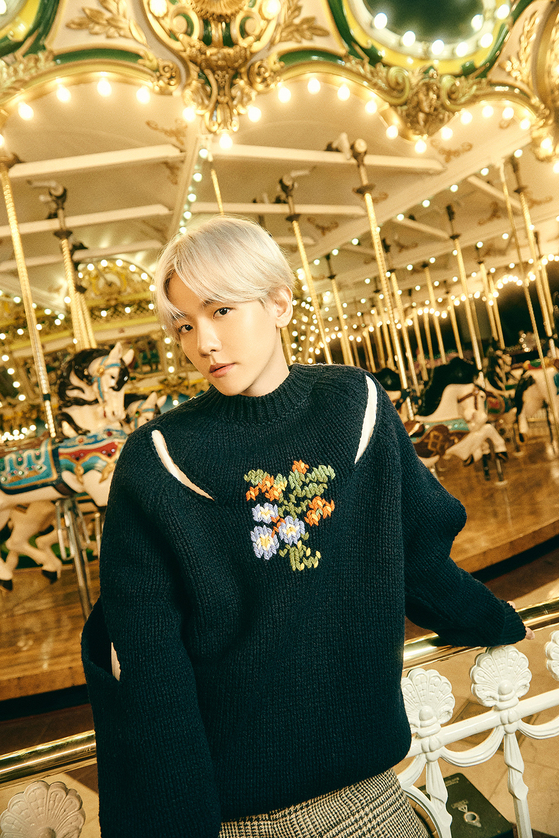 The first official teaser image for singer Baekhyun's upcoming single ″Amusement Park″ set to drop on Dec. 21. [SM ENTERTAINMENT]