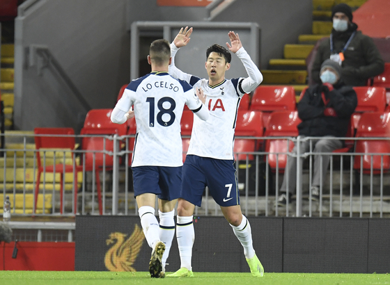 Son Heung-min of Tottenham Hotspur, right, celebrates with teammate Giovani Lo Celso after scoring a goal during the English Premier League match against Liverpool at Anfield on Wednesday. [AP/YONHAP]