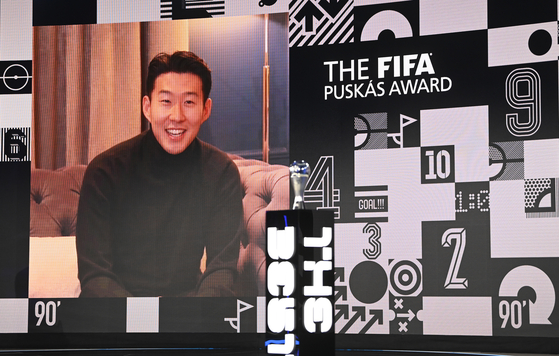 Son Heung-min of Tottenham Hotspur smiles during a video interview after winning the Puskas award at the Best FIFA Football Awards Ceremony in Zurich, Switzerland, Thursday. [AP/YONHAP]