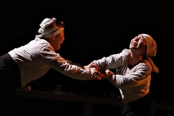 """A scene from """"Haenyeo Kitchen,"""" a play that features real haenyeo in Jeju Island. [HAENYEO KITCHEN]"""