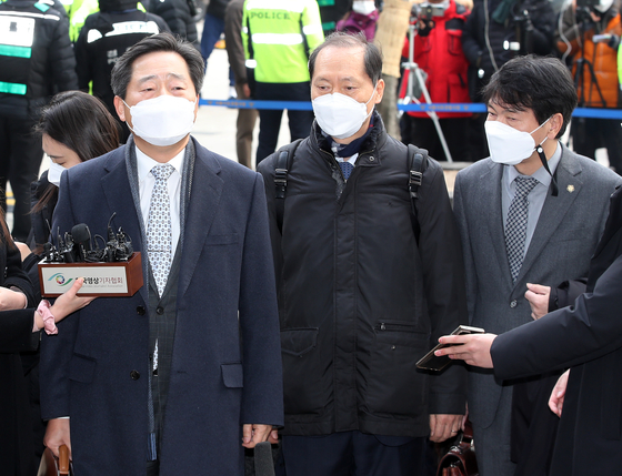 Prosecutor General Yoon Seok-youl's three lawyers stand before the reporters on Tuesday as they enter the Seoul Administrative Court to attend a hearing to seek an injunction to halt the administration's suspension of the top prosecutor. [YONHAP]
