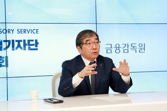 Gov. Yoon Suk-heun of the Financial Supervisory Service speaks during an online press briefing held Wednesday. [FINANCIAL SUPERVISORY SERVICE]