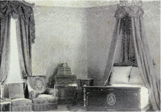An old black-and-white photograph of the emperor's bedroom. [CULTURAL HERITAGE ADMINISTRATION]