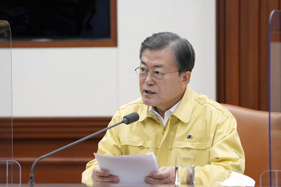 At a meeting on Dec. 13 of the Central Disaster and Safety Countermeasures Headquarters in Seoul, President Moon Jae-in urges drastic action on social distancing if needed. [JOINT PRESS CORPS]