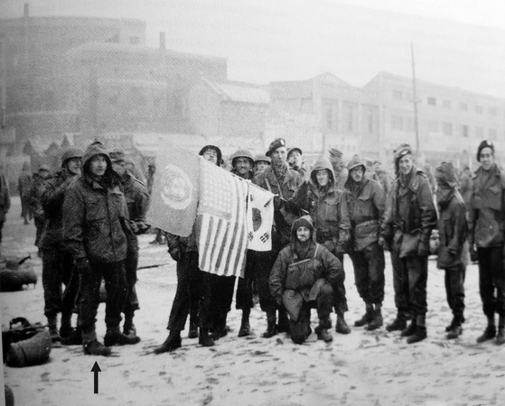 Dutch soldiers in Daegu on Dec. 4, 1950, waiting for the train to the front lines. [DIRK FREDERIK HERMANS]