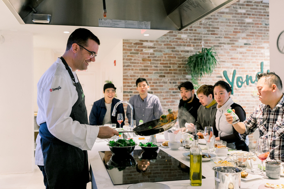Chef. Jaume Biarnés cooks using Sempio Foods' Yondu cooking essence at a workshop hosted at Yondu Culinary Studio in New York in 2018. [SEMPIO FOODS]