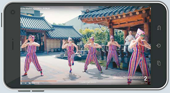 """Ambiguous Dance Company members dance to the music of Leenalchi in the video """"Feel the Rhythm of Korea; jeonju."""" [Screen Capture]"""
