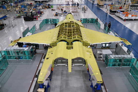 Assembly work is underway on the KF-X, Korea's first indigenous fighter jet jointly developed with Indonesia, as shown in a photograph from the Defense Acquisition Program Administration. [NEWS1]