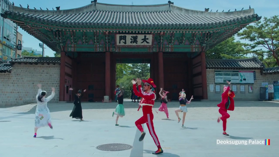 "A scene featuring Leenalchi band dancing in front of central Seoul's Deoksu Palace is from the promotional video ""Feel the Rhythm of Korea"" by the Korea Tourism Organization. [SCREEN CAPTURE]"